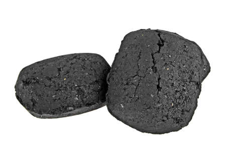 power: Two pieces of charcoal isolated on a white background Stock Photo