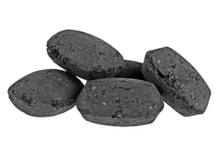 power: Heap of coal briquette for BBQ isolated on white background