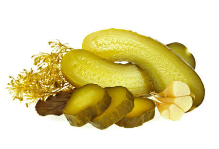 Pickled cucumber slices and spices on a white background