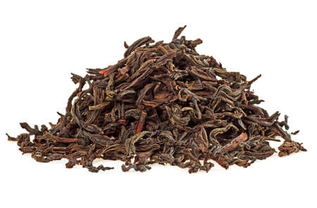 Dry tea leaves isolated on a white background, close up