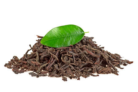 Dry black tea with leaf isolated on a white background