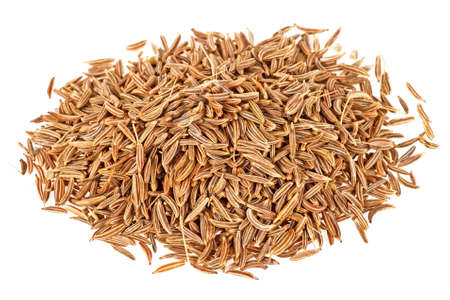 Dried cumin seeds on a white background Stock Photo