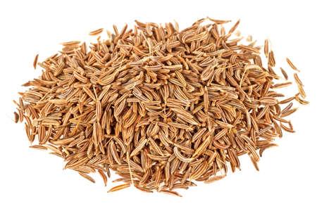 Dried cumin seeds on a white background Foto de archivo