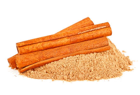 Cinnamon sticks and cinnamon powder, white background