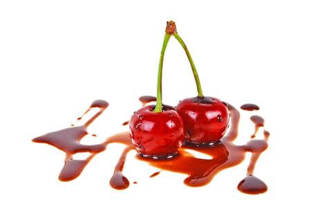 Group of chocolate covered cherries, white background