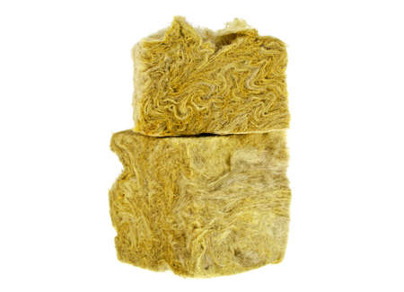 Pieces of yellow fiberglass insulation mat isolated on white background