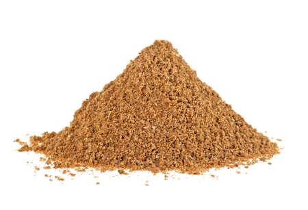 Heap of coriander powder on white background Stockfoto