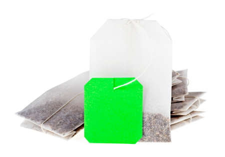 Close-up of tea bags isolated on white background