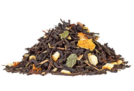 Pile of aromatic dry tea with fruits on white background. Orange fruit and lemon grass.
