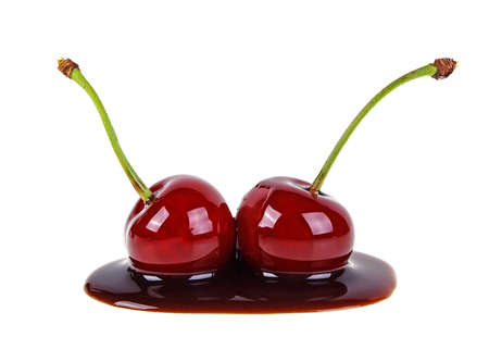 Two cherries filled with hot chocolate on a white background Banque d'images