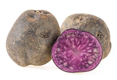 Purple potatoes on a white background. Vitelotte potatoes.