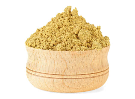 Mustard powder in wooden bowl on a white background 스톡 콘텐츠