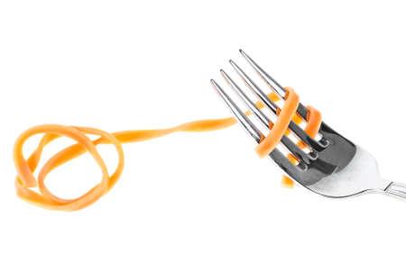 Spaghetti pasta on fork with swirl, on white background. Pasta tagliatelle.