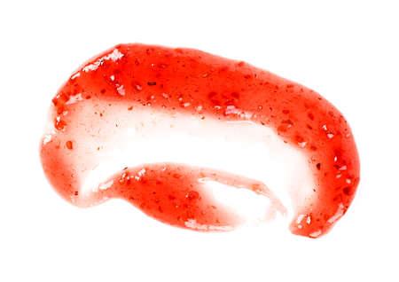 Raspberry jam smeared on a white background