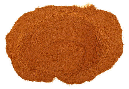 Cinnamon powder isolated on a white background, top view. Stockfoto