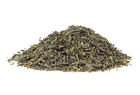 Pile of green tea leaves on a white background