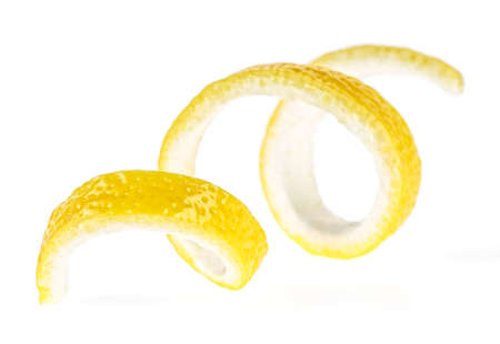 Lemon peel on a white background, close-up. Lemon twist. Stock Photo