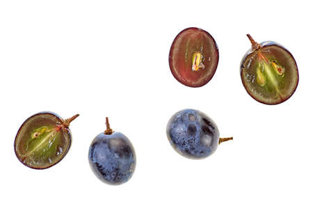 Fresh blue grape on a white background, top view.