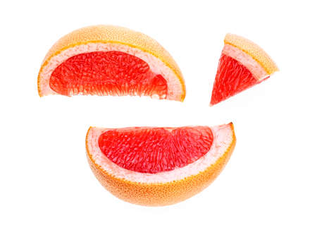 Grapefruit slices isolated on white background, top view. 免版税图像