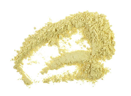 Dry ginger powder isolated on white background, top view. Stock Photo