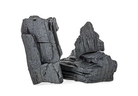 Pile of charcoal isolated on a white background