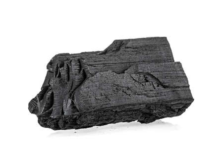 Traditional charcoal or hardwood charcoal isolated on a white background Imagens