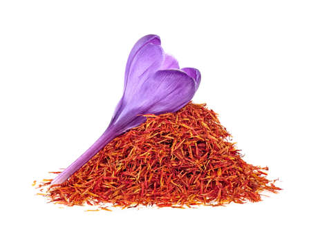 Flower crocus and dried saffron spice isolated on white background