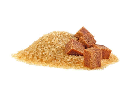 Brown sugar cubes and crystal sugar on white background Фото со стока