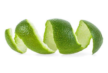 Peel of lime over white background, closeup.