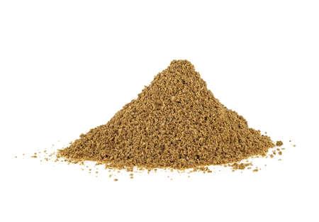 Heap of coriander powder on white background Stock Photo