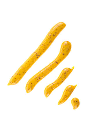 Mustard sauce. Strips of mustard on a white background.