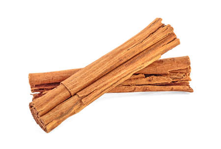 Close up of cinnamon sticks isolated on white background. Ceylon cinnamon.