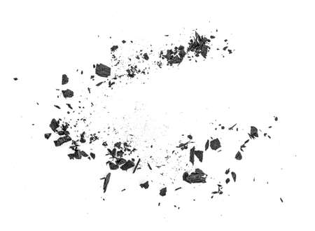 Black coal dust with fragments isolated on white background, top view.