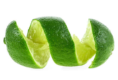 Cut lime in shape of a spiral on white background