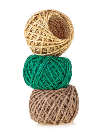 Colored rolls of rope on a white background. Household rope.