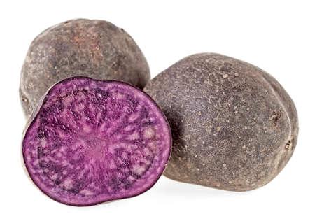 Fresh vitelotte potatoes isolated on a white background Imagens