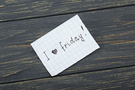 Inscription on paper I love friday on a wooden board Imagens