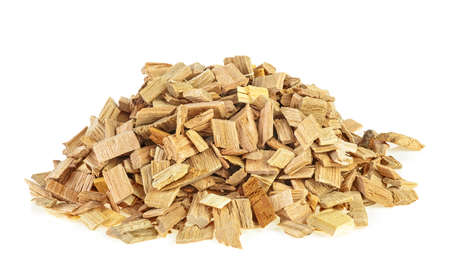 Wooden smoking chips for smoking on a white background. Wood smoking chips. Full depth of field. Stock fotó