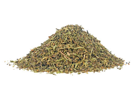 Pile of dried savory seasoning isolated on a white background