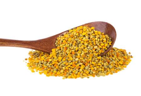 Honey bee pollen in wooden spoon over white background Standard-Bild - 133908456