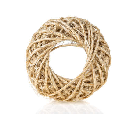 Rope coil roll on a white background. Household rope.
