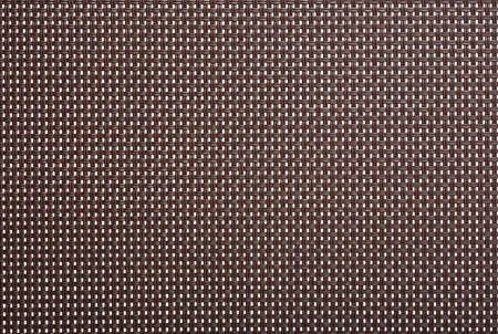 Wicker background texture plastic furniture. Plastic weaving texture. Brown plastic weave for background.
