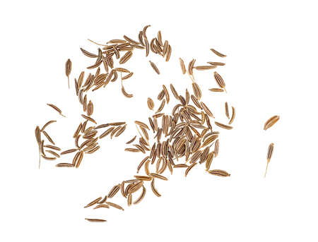 Pile of cumin seeds isolated on a white background, top view.