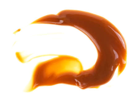 Caramel sauce isolated on a white background
