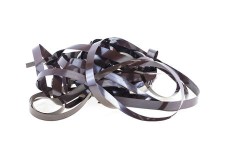 Close up of magnetic audio tape reel. Cassette tape isolated on a white background. Magnetic audio cassette tangle. Reel film.