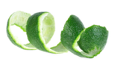 Peel of fresh lime over white background. Lime fruit peel. Curly lime peel twist.