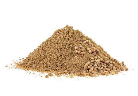 Indian spices - Coriander powder and seeds isolated on a white background.
