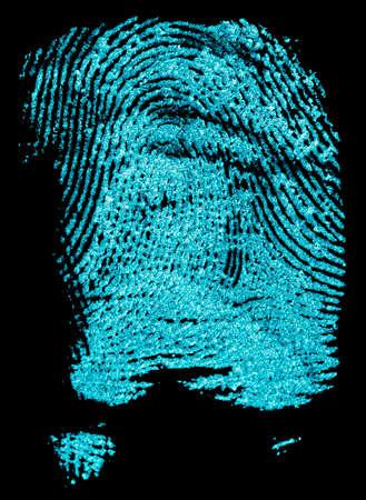 Fingerprint with ultraviolet lamp. Fingerprint on a black background. Concept of crime scene. Foto de archivo