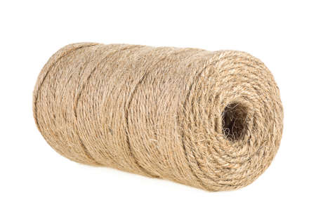 Jute skein isolated on a white background. Jute twine close-up. Natural brown rope. Standard-Bild