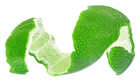Peel of green citrus fruit isolated on a white background. Lime skin. Curly lime peel twist.